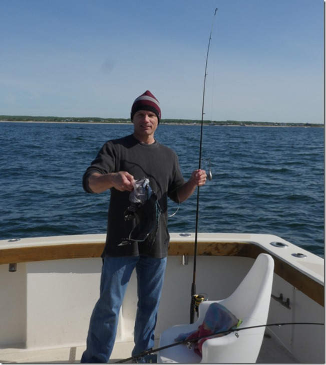 Dan catches a nice sea bass aboard the aces wild ri fishing charter