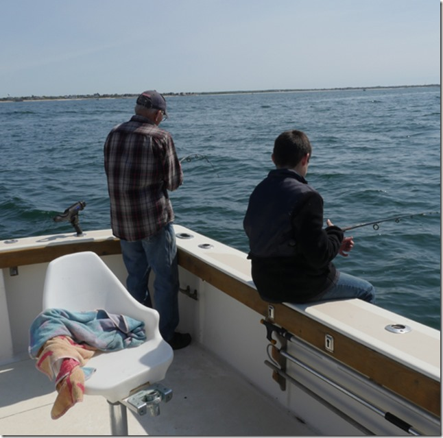 matt and grandpa waiting for a fish
