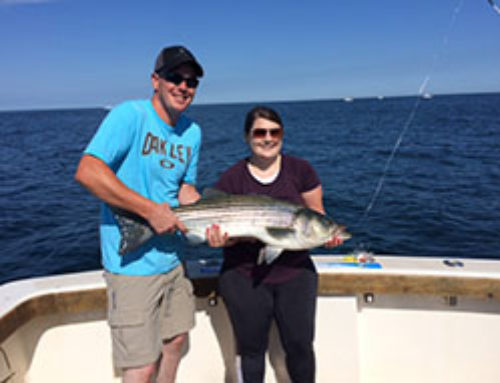 The Knepley's Hook Into 4 Large Striped Bass and 2 Blue Fish on their RI Fishing Charter