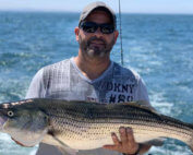 aces wild Rhode island striped bass fishing charters we are catching the monsters